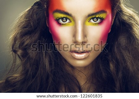 pretty girl with eye shadows on face - stock photo