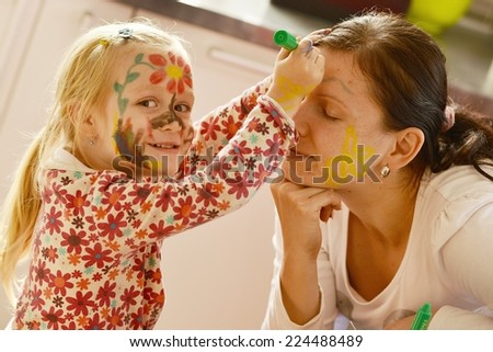 Pretty girl with face painting - stock photo
