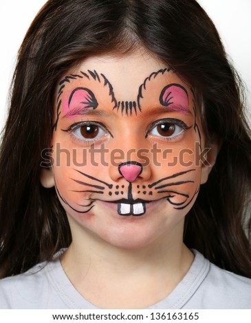 Pretty girl with face painting of a mouse - stock photo