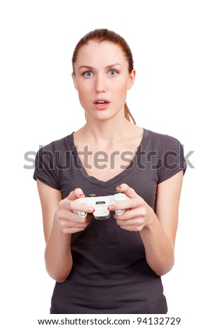 Pretty girl with gamepad playing. Isolated against white background - stock photo