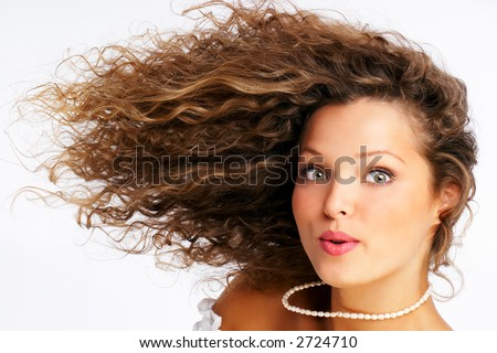 Pretty girl with great hair. Isolated over white background
