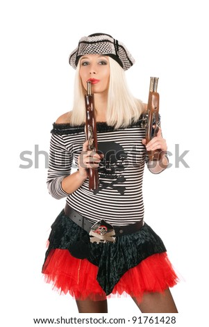 Pretty girl with guns dressed as pirates - stock photo