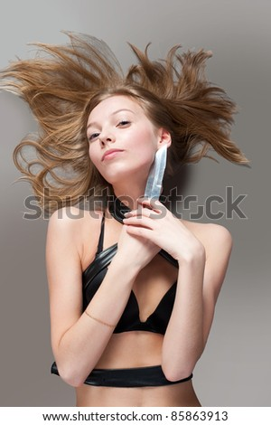 Pretty girl with knife - stock photo
