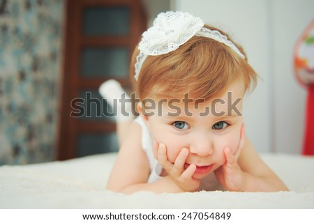 pretty girl with lace headband on bed - stock photo