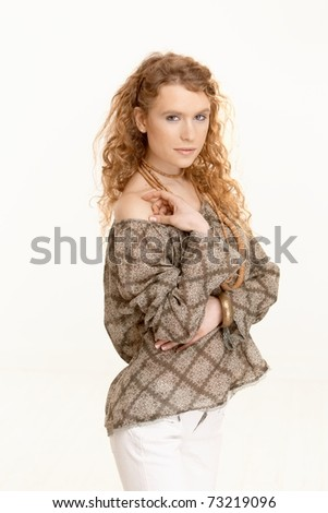 Pretty girl with long curly hair looking at camera shoulders uncovered.? - stock photo