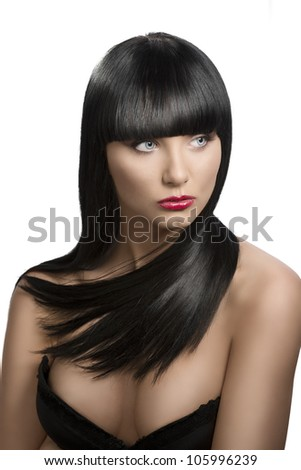pretty girl with long, dark smooth hair and fringe, she is in front of the camera and looks at left - stock photo
