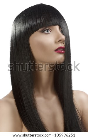 pretty girl with long, dark smooth hair and fringe, she is turned of three quarters at left and the left side of the face is hidden by the hair