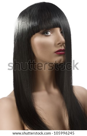 pretty girl with long, dark smooth hair and fringe, she is turned of three quarters at left with the left side of the face hidden by the hair, she looks in to the lens