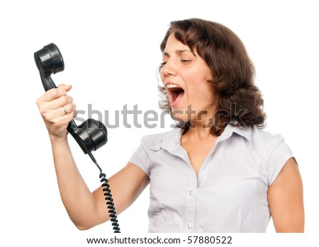 Pretty girl with old-style telephone - stock photo