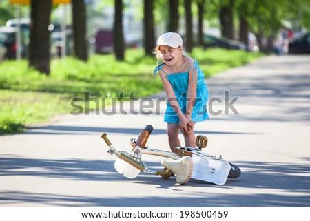 Pretty girl with pain in knee when fallen down - stock photo