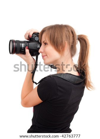 Pretty girl with photo camera. Side view. Isolated on white