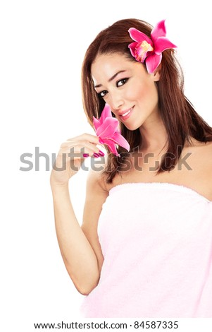 Pretty girl with pink flowers, isolated on white background, spa & relaxation concept - stock photo