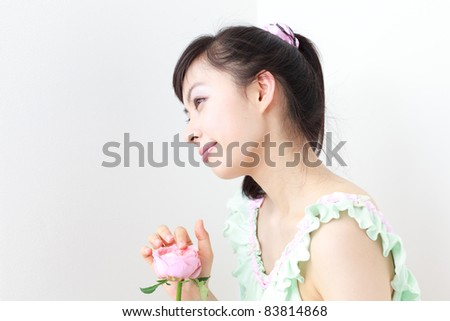 pretty girl with pink rose