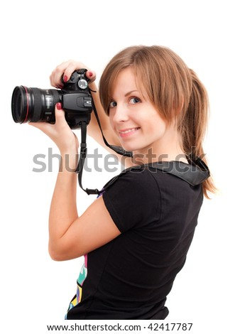Pretty girl with professional photo camera. Over white - stock photo