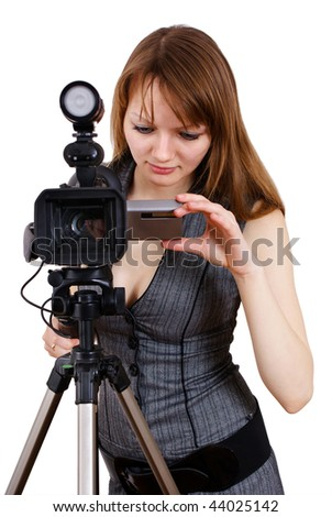 Pretty girl with professional video camera. Isolated on white.