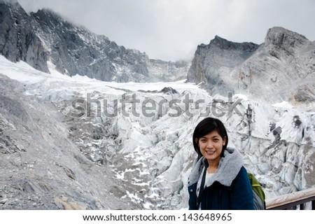 pretty girl with snowy mountains, happy wintertime holidays