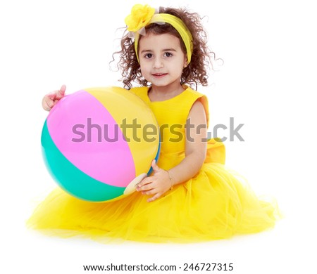 pretty girl with striped inflatable ball.Isolated on white background - stock photo