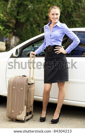 Pretty girl with suitcase - stock photo