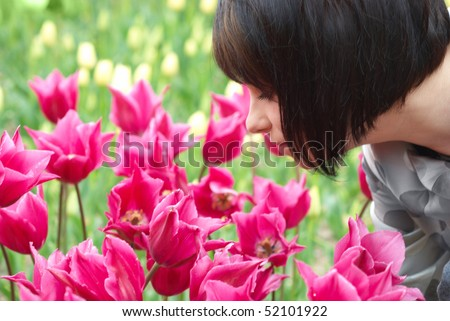 Pretty girl with tulips with soft background