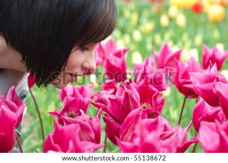 Pretty girl with tulips with soft background - stock photo