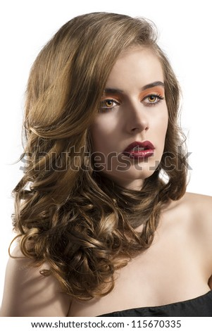 pretty girl with wavy hair and red lipstick, she is turned of three quarters at left and looks in front of her - stock photo