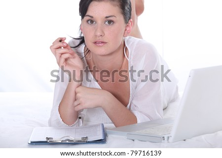 pretty girl working with her laptop - stock photo