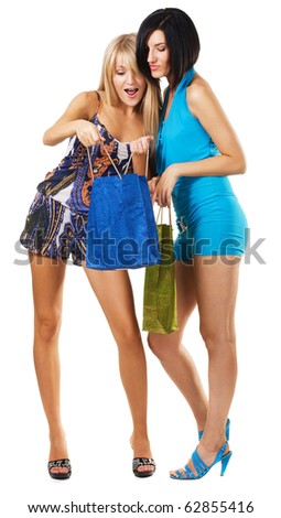 Pretty girls with shopping bags, isolated on white