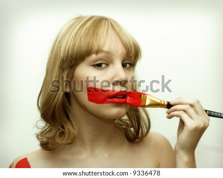 pretty green-eyes girl with brush and red lips - stock photo