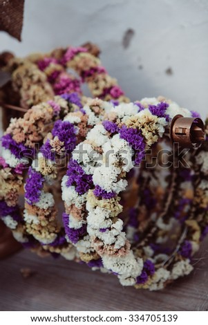 Pretty handmade flower garlands made from dry flowers - stock photo