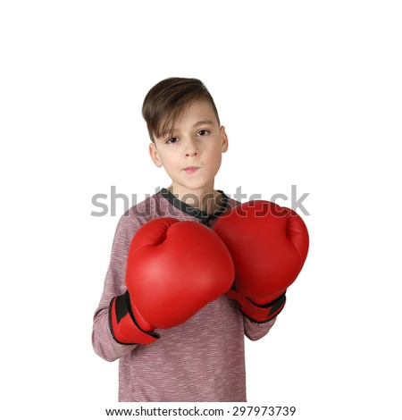 Pretty handsome boy in boxing gloves stands in stance isolated on white background