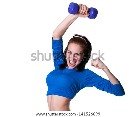 Pretty happy brawny sporty young woman model in blue top lifting up dumbbell, smiling cheerfully, laughing loudly, looking at camera. Isolated on white background