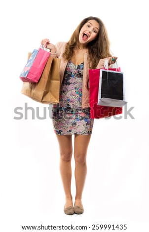 Pretty happy woman holding shopping bags