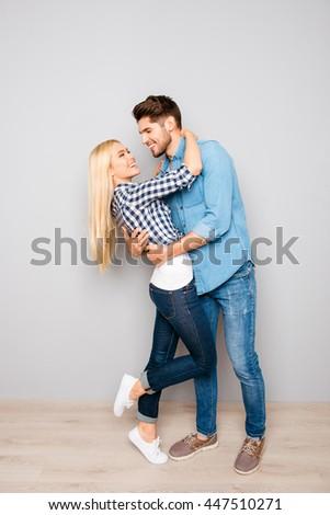Pretty happy woman huging her handsome boyfriend - stock photo