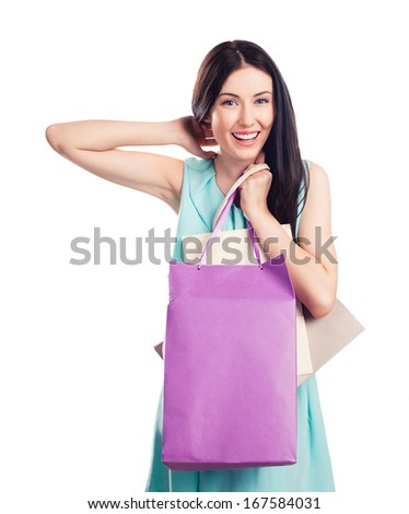Pretty happy young woman holding shopping bags. Isolated on white background - stock photo