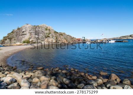 Pretty harbour at Kjerringvik, Norway - stock photo