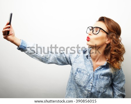 Pretty hipster girl taking selfie.  - stock photo