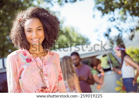 Pretty hipster smiling at camera at a music festival - stock photo