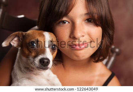 Pretty Hispanic Girl and Her Jack Russell Terrier Puppy Studio Portrait. - stock photo