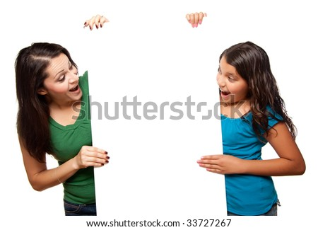 Pretty Hispanic Girl and Mother Holding Blank Board Isolated on a White Background. - stock photo