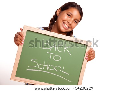 Pretty Hispanic Girl Holding Chalkboard with Back To School Isolated on a White Background. - stock photo