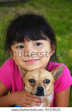 Pretty hispanic girl holding her chihuahua - stock photo