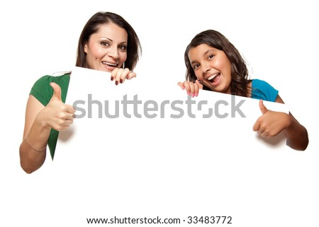 Pretty Hispanic Teen Aged Girl and Mother Holding Blank Board Isolated on a White Background. - stock photo