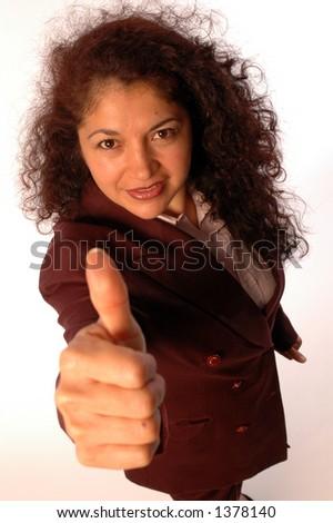 pretty hispanic woman making positive hand sign - stock photo