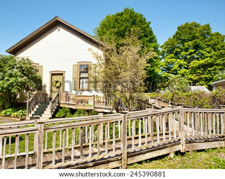 pretty home with wooden handicap ramp - stock photo