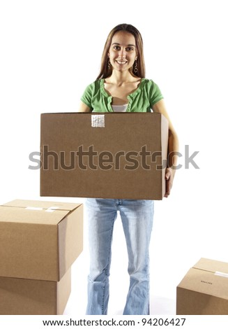 Pretty homemaker packing to move to a new home or just moved in and moving stored items around to different rooms in the house or warehouse worker moving boxes. In studio on white background.
