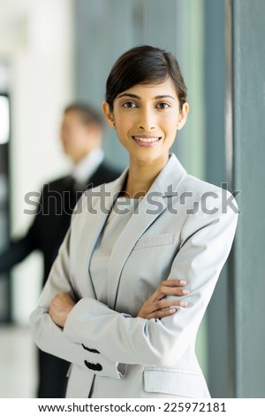 pretty indian business woman with arms crossed - stock photo