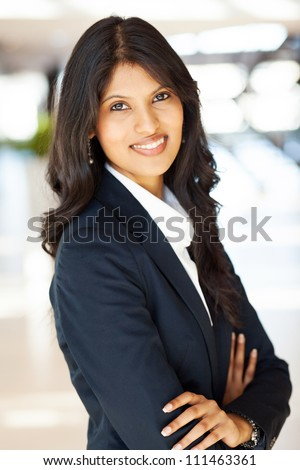 pretty indian businesswoman half length portrait - stock photo