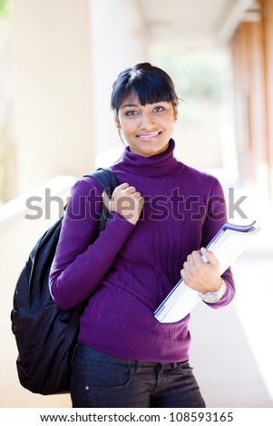 pretty indian college girl on campus - stock photo
