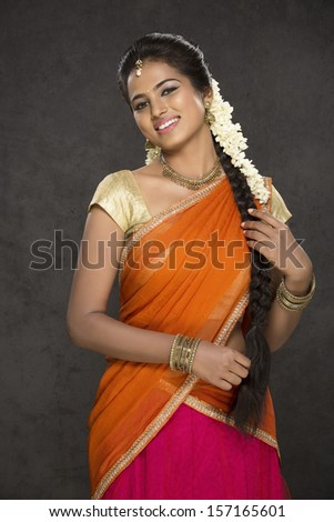 Pretty Indian girl in traditional Indian half sari - stock photo
