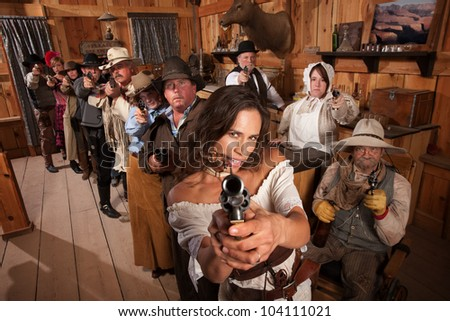 Pretty Indian gunfighter with revolver and dagger in her mouth - stock photo